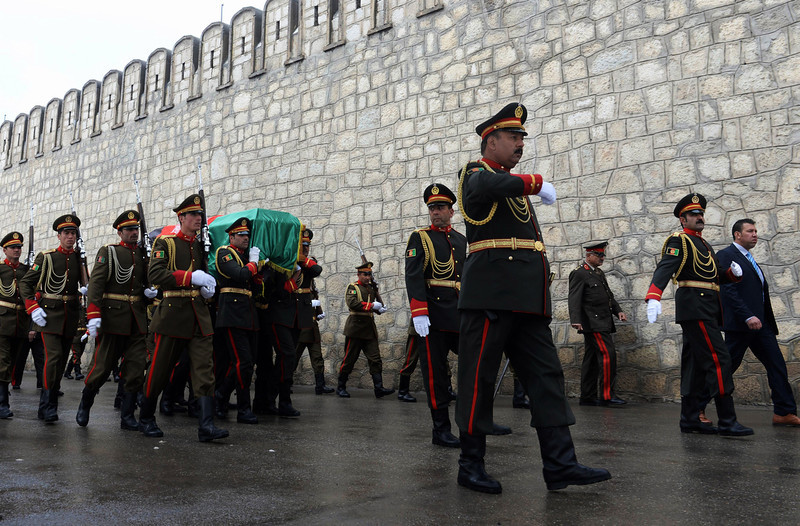 . Afghan honor guards carry the coffin of Afghanistan\'s influential Vice President Mohammad Qasim Fahim during his funeral procession in Kabul, Afghanistan, Tuesday, March 11, 2014. (AP Photo/Shah Marai, Pool)