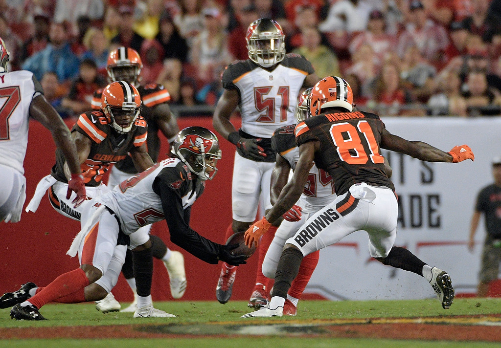 . Tampa Bay Buccaneers cornerback Vernon Hargreaves III (28) intercepts a pass intended for Cleveland Browns wide receiver Rashard Higgins (81) during the second quarter of an NFL preseason football game Saturday, Aug. 26, 2017, in Tampa, Fla. (AP Photo/Phelan Ebenhack)