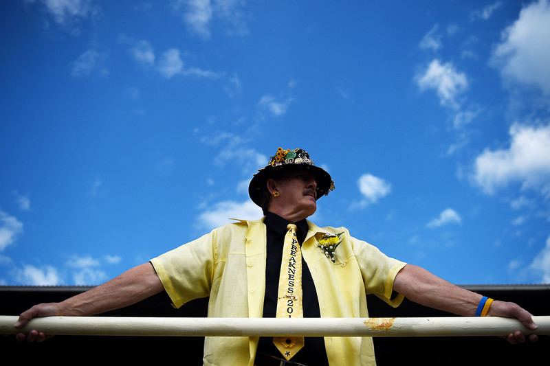 . A man wears a decorative hat prior to the 139th running of the Preakness Stakes at Pimlico Race Course on May 17, 2014 in Baltimore, Maryland.  (Photo by Patrick Smith/Getty Images)