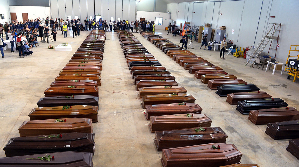 . Coffin of victims are seen in an hangar of Lampedusa airport on October 5, 2013, after a boat with migrants sank, killing more than a hundred people. Italy mourned the African asylum-seekers feared dead in the worst ever Mediterranean refugee disaster, as the government appealed for Europe to stem the influx of migrants.  ALBERTO PIZZOLI/AFP/Getty Images