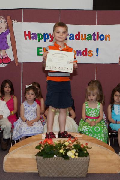K.C. displaying his diploma.