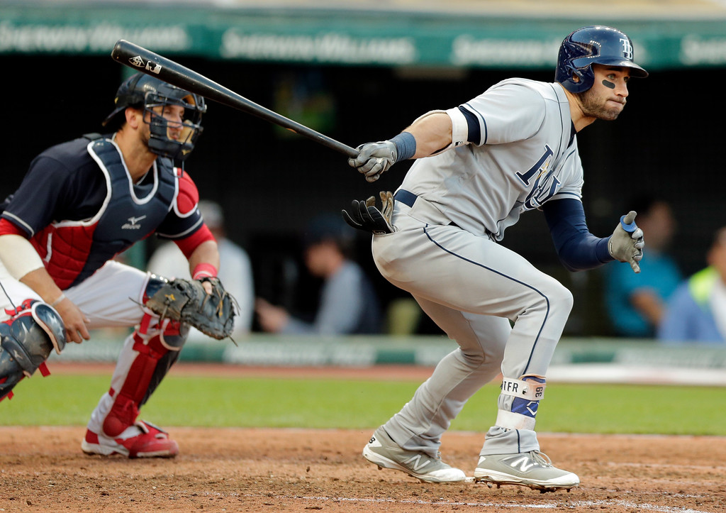. Tampa Bay Rays\' Kevin Kiermaier watches his ball after hitting a single in the fifth inning of a baseball game against the Cleveland Indians, Monday, May 15, 2017, in Cleveland. Cleveland Indians\' Yan Gomes watches. (AP Photo/Tony Dejak)