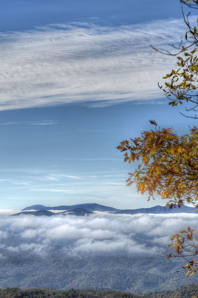 View of clouds wrapping the mountains at the overlook at the Visitors Center at Grayson Highlands State Park in Mouth of Wilson, VA on Tuesday, October 15, 2013. Copyright 2013 Jason Barnette