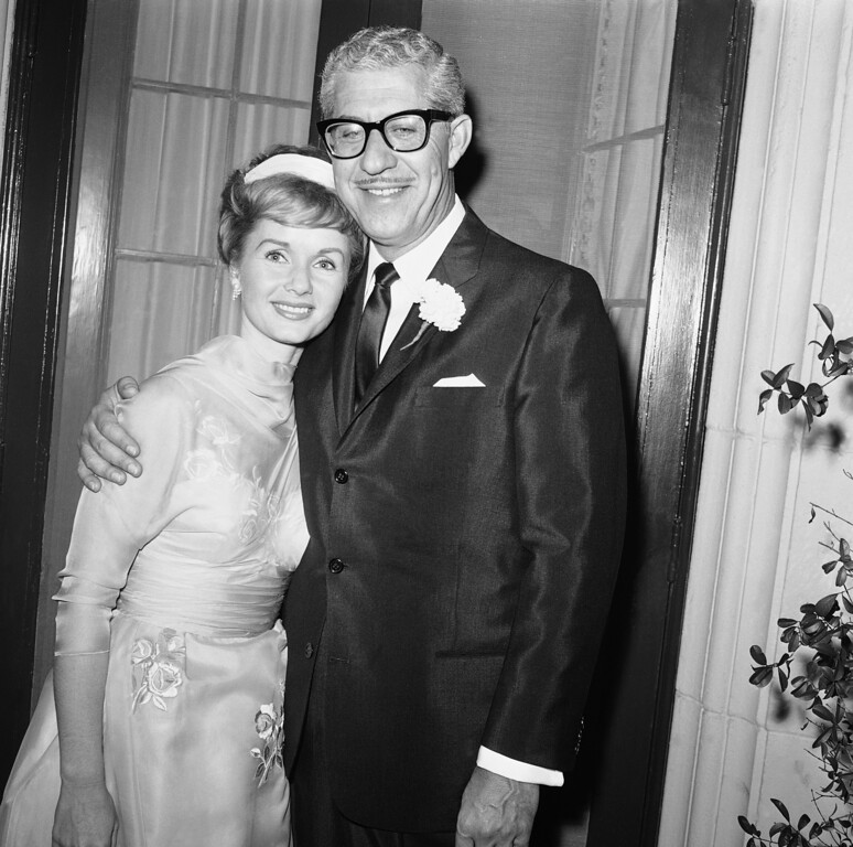 . Actress Debbie Reynolds, 29, and millionaire shoe magnate Harry Karl, 46, are a happy pair as they pose for photographers just after their marriage at Beverly Hills, Calif., Nov. 26, 1960. She is the former wife of Eddie Fisher, and Karl\'s fourth bride. (AP Photo/Harold P. Matosian)