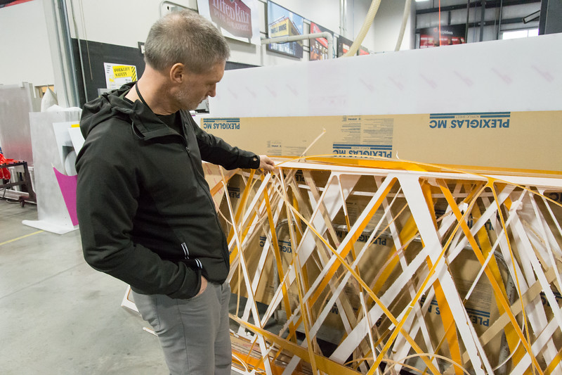 02/15/19  Wesley Bunnell | Staff  Director of Public Works Mark Moriarty examines colored plexiglass which was used for triangle trim pieces to be installed on the outside of the upcoming Beehive Bridge Project. Mayor Erin Stewart along with other city employees visited Sign Pro in Southington on Friday morning for an update on their work.