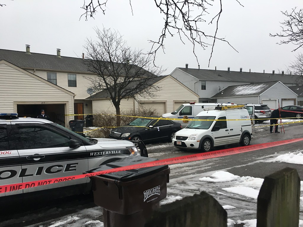 . Police tape cordons off the area where two Westerville, Ohio, police officers were shot and killed responding to a hang-up 911 call, on Saturday, Feb. 10, 2018. The officers were shot around noon after entering the residence. (AP Photo/Andrew Welsh-Huggins)