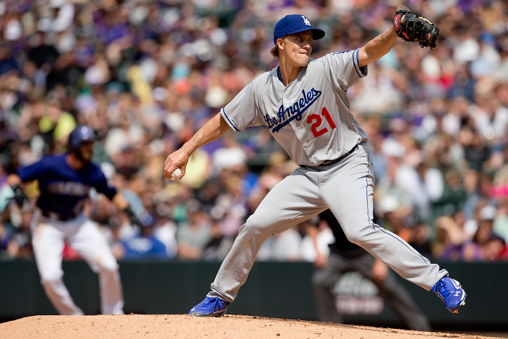 . DENVER, CO - JUNE 7:  Starting pitcher Zack Greinke #21 of the Los Angeles Dodgers delivers to home plate during the fifth inning against the Colorado Rockies at Coors Field on June 7, 2014 in Denver, Colorado. The Rockies defeated the Dodgers 5-4 in 10 innings to end their eight game losing streak. (Photo by Justin Edmonds/Getty Images)