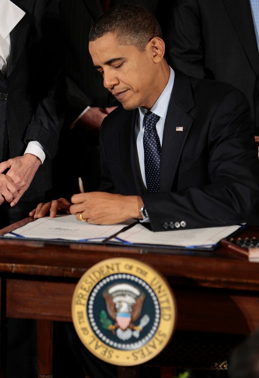 . President Barack Obama signs the Veterans Health Care Budget Reform and Transparency Act during a ceremony in the East Room of the White House in Washington, Thursday, Oct. 22, 2009. (AP Photo/Pablo Martinez Monsivais)