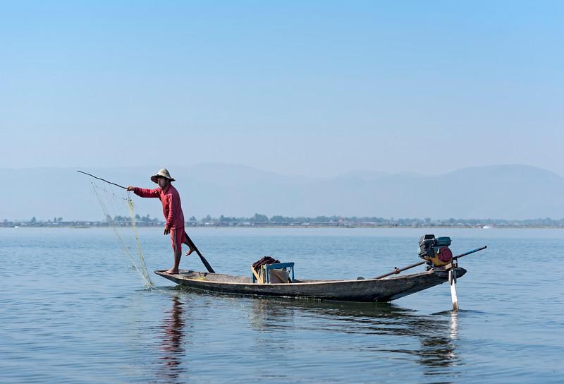 Intha fisherman throwing net, Inle Lake, Burma (Myanmar)