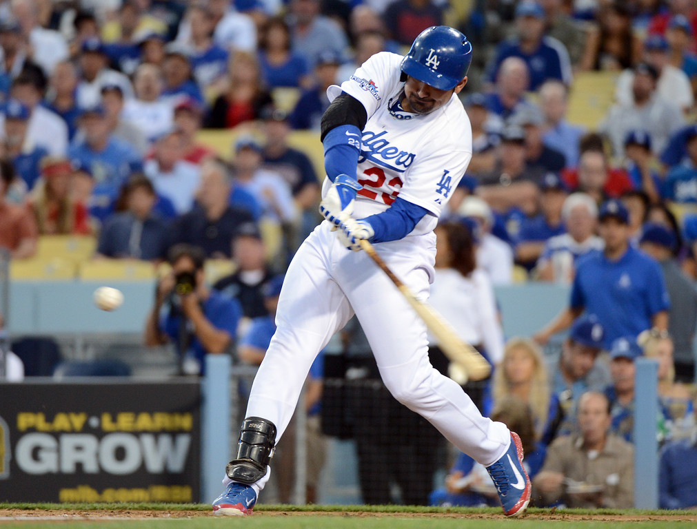 . Los Angeles Dodgers\' Adrian Gonzalez hits a double in the fourth during game 4 of the NLCS at Dodger Stadium against the St. Louis Cardinals Tuesday, October 15, 2013. (Photo by David Crane/Los Angeles Daily News)
