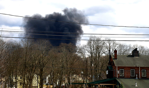 3/19/2019 Mike Orazzi | Staff Dark plumes of smoke visible in Plantsville as the Southington Fire Department battled a car fire at Chuck & Eddie's Used Auto Parts on Old Turnpike Rd, Southington Tuesday afternoon.