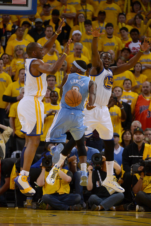 . OAKLAND, CA. - APRIL 26: Ty Lawson (3) of the Denver Nuggets makes a pass behind his back on Carl Landry (7) of the Golden State Warriors and Draymond Green (23) in game 3 of the first round of the NBA Playoffs April 26, 2013 at Oracle Arena.  (Photo By John Leyba/The Denver Post)