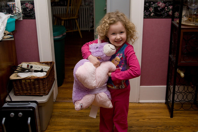 Beverly hugs her new unicorn pillow pet