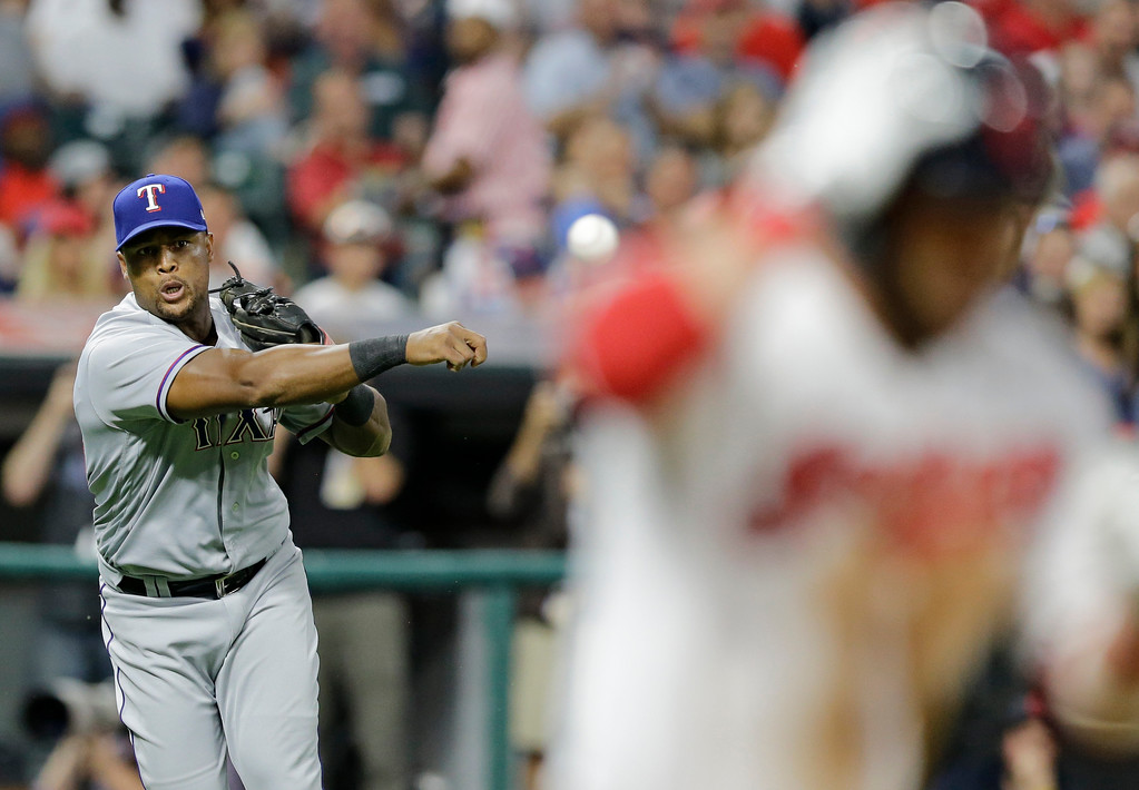 . Texas Rangers relief pitcher Ernesto Frieri, left, throws out Cleveland Indians\' Jason Kipnis at first base after Kipnis bunted in the seventh inning of a baseball game, Wednesday, June 28, 2017, in Cleveland. (AP Photo/Tony Dejak)