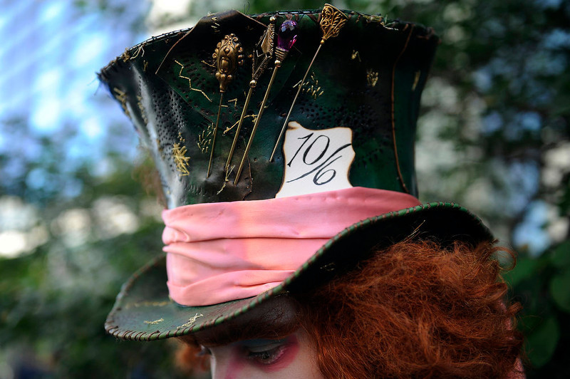 . Chad Edward Evett from La Junta, Colorado dressed as the Mad Hatter from Alice in Wonderland displays the details of his hand made leather top hat during Denver Comic Con at the Colorado Convention Center on June 2, 2013 in Denver, Colorado. (Photo by Seth McConnell/The Denver Post)