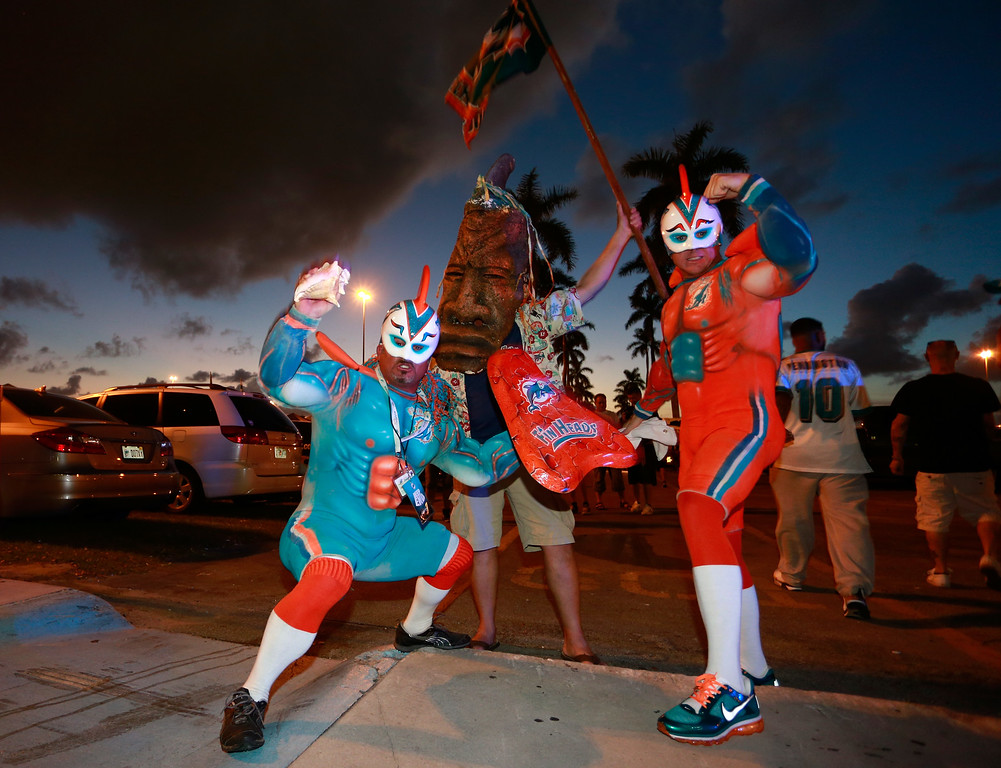 . Fans pose for photographs on Halloween prior to the game between the Miami Dolphins and the Cincinnati Bengals at Sun Life Stadium on October 31, 2013 in Miami Gardens, Florida. (Photo by Chris Trotman/Getty Images)