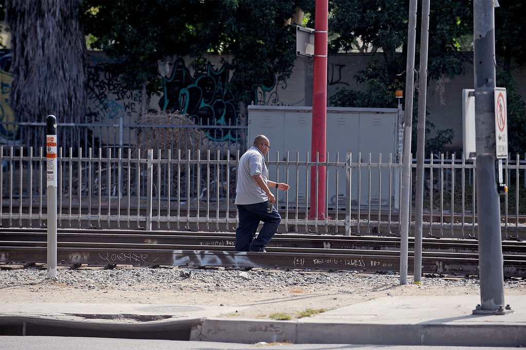 . COMPTON, CA - AUGUST 21:  Train crossing violators on August 21, 2013 at Willowbrook Blue Line Station in Los Angeles, California.  (Photo courtesy of the Metropolitan Transit Authority)