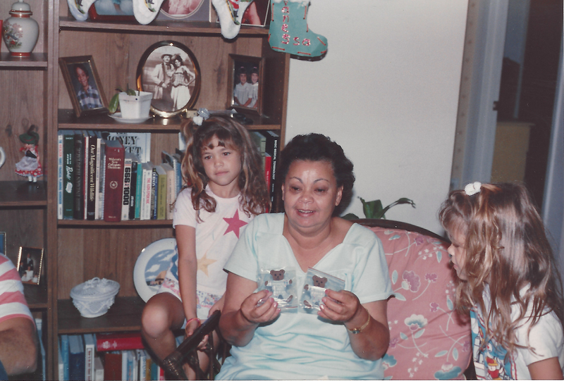 Carmen opens presents with the twins .png