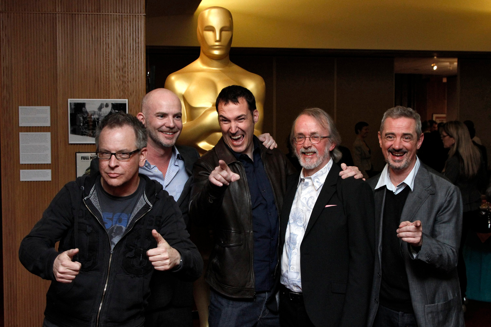 Description of . Animated Feature Film nominees and directors (L-R) Rich Moore, Chris Butler, Mark Andrews, Peter Lord, and Sam Fell pose for photographers at Oscar Celebrates: Animated Features, featuring this year's Oscar-nominated Animated Feature Films category at the Academy of Motion Picture Arts and Sciences in Beverly Hills, California, February 21, 2013. REUTERS/Jonathan Alcorn