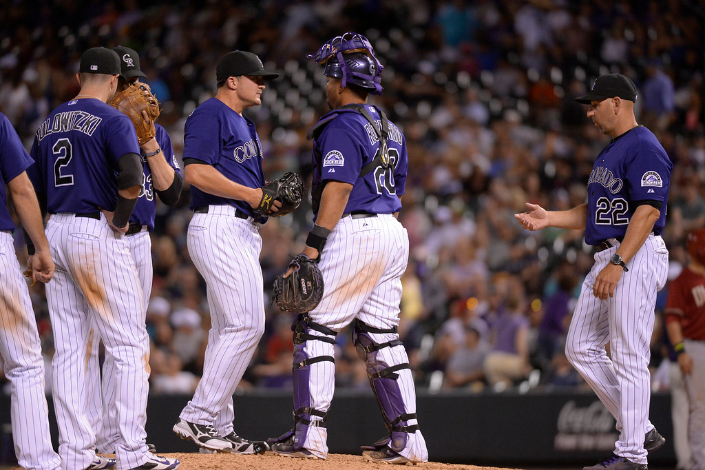. Colorado Rockies manager Walt Weiss (22) comes out to pull Colorado Rockies relief pitcher Rex Brothers (49) in the ninth inning against the Arizona Diamondbacks June 4, 2014 at Coors Field. (Photo by John Leyba/The Denver Post)