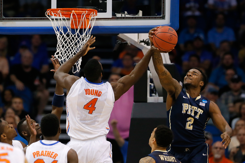 . Michael Young #2 of the Pittsburgh Panthers blocks the shot of Patric Young #4 of the Florida Gators in the first half during the third round of the 2014 NCAA Men\'s Basketball Tournament at Amway Center on March 22, 2014 in Orlando, Florida.  (Photo by Kevin C. Cox/Getty Images)