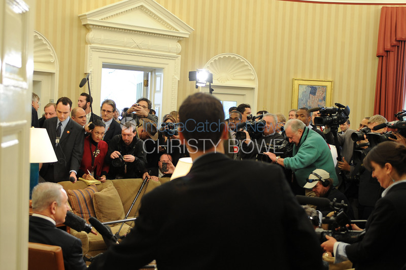 The media swarm into the Oval Office for a brief photo op as as the meeting begins.