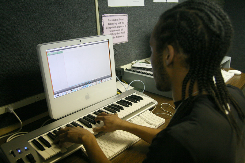 Omar Wingo, a freshman Music Education major, works in the music lab late Wednesday night.