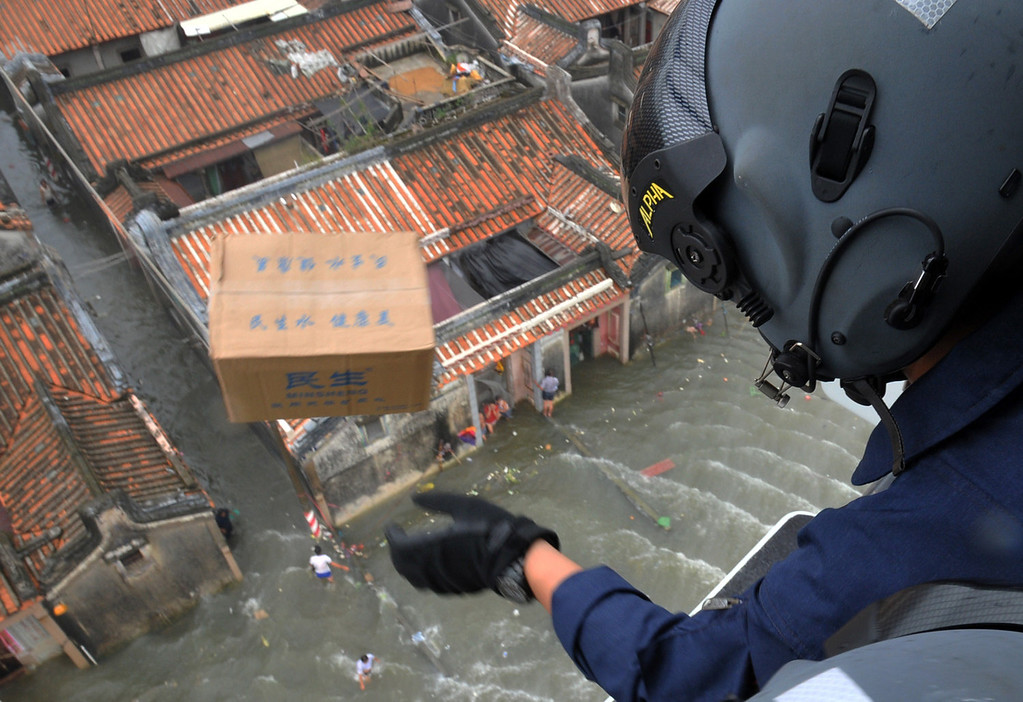 . A rescuer drops a box of food from a helicopter in flood-hit Shantou, in southern China\'s Guangdong province on August 21, 2013. The death toll from devastating floods at opposite ends of China following torrential rains and the aftermath of a typhoon has risen to more than 130, the government and media said on August 20.   AFP PHOTOSTR/AFP/Getty Images