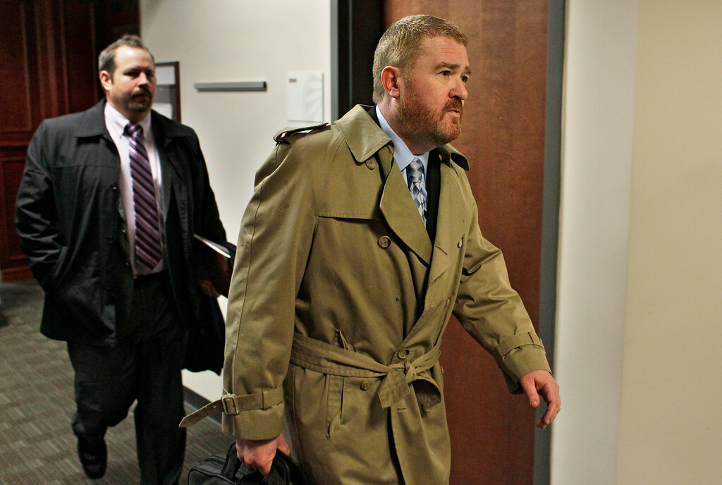 . Daniel King, right, defense attorney for Aurora shooting suspect James Holmes, along with an unnamed member of his team, left, departs district court following an arraignment Holmes, in Centennial, Colo., on Tuesday, March 12, 2013.  (AP Photo/Brennan Linsley)