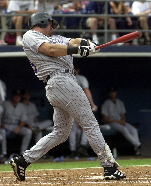 . Colorado Rockies\' Larry Walker crushes his 26th home run of the season in the third inning of the Rockies\' 4-0 victory over the San Diego Padres Thursday, July 5, 2001, in San Diego. (AP Photo/Lenny Ignelzi)