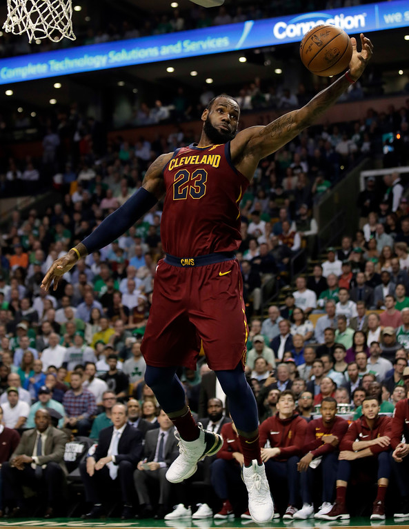 . Cleveland Cavaliers forward LeBron James grabs a pass under the basket during the first half in Game 2 of the NBA basketball Eastern Conference finals against the Boston Celtics, Tuesday, May 15, 2018, in Boston. (AP Photo/Charles Krupa)