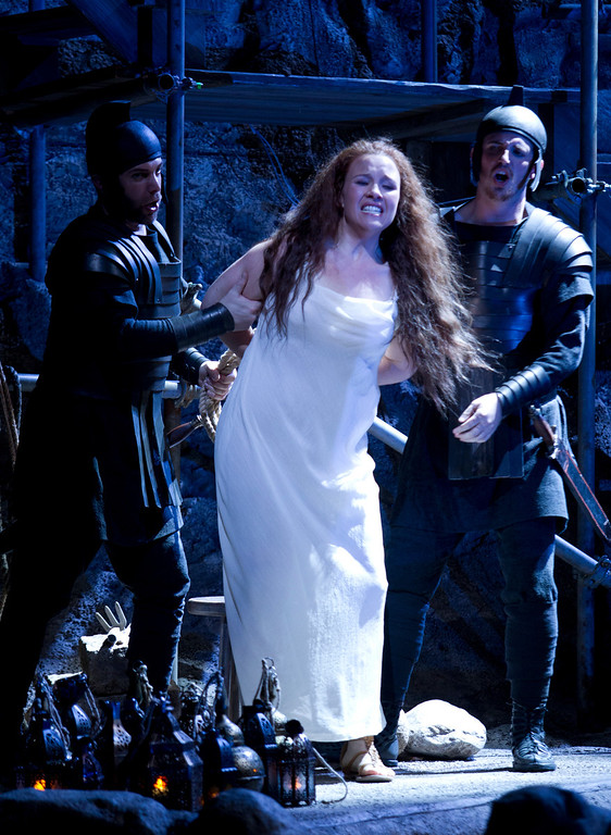 ". Police charge Mary Magdalene (Sasha Cooke), center, with adultery and prostitution, in a scene from San Francisco Opera\'s world premiere of Mark Adamo\'s ""The Gospel of Mary Magdalene,\"" Sunday, June 16, 2013 at the War Memorial Opera House in San Francisco. (D. Ross Cameron/Bay Area News Group)"