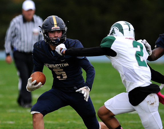 10/25/2019 Mike Orazzi | StaffrNewington High Schools Gunnar Johnson r (5) during Friday afternoons football game with Maloney High School in Newington. rrr