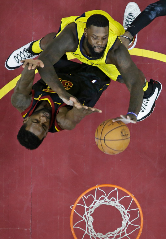 . Indiana Pacers\' Lance Stephenson, top, drives to the basket against Cleveland Cavaliers\' Jeff Green in the second half of Game 1 of an NBA basketball first-round playoff series, Sunday, April 15, 2018, in Cleveland. The Pacers won 98-80. (AP Photo/Tony Dejak)