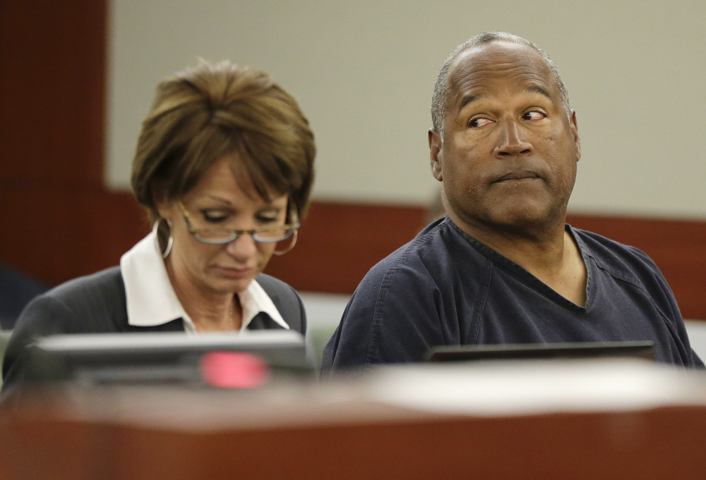 . O.J. Simpson (R) sits with his attorney, Patricia Palm during his evidentiary hearing in Clark County District Court May 13, 2013 in Las Vegas, Nevada. Simpson, who is currently serving a nine to 33-year sentence in state prison as a result of his October 2008 conviction for armed robbery and kidnapping charges, is using a writ of habeas corpus, to seek a new trial, claiming he had such bad representation that his conviction should be reversed.  (Photo by Julie Jacobson - Pool/Getty Images)