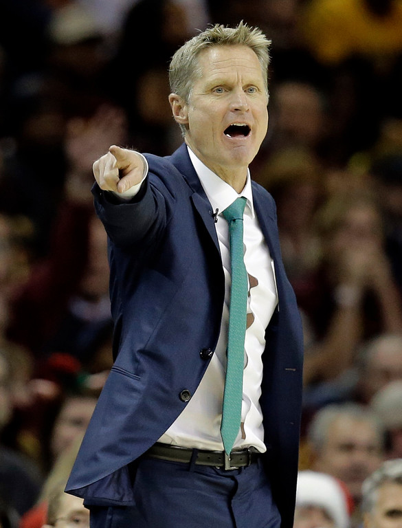 . Golden State Warriors head coach Steve Kerr yells to players in the second half of an NBA basketball game against the Cleveland Cavaliers, Sunday, Dec. 25, 2016, in Cleveland. The Cavaliers won 109-108. (AP Photo/Tony Dejak)