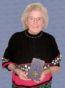 Gladys Beamish with Warren's Distinguished Service Cross