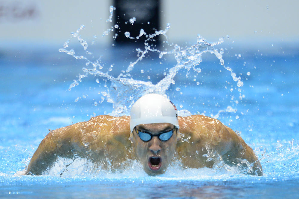 Description of . US swimmer Michael Phelps competes in the men's 200m butterfly heats swimming event at the London 2012 Olympic Games at the Olympic Park in London on July 30, 2012.  AFP PHOTO / LEON  NEAL/AFP/Getty Images
