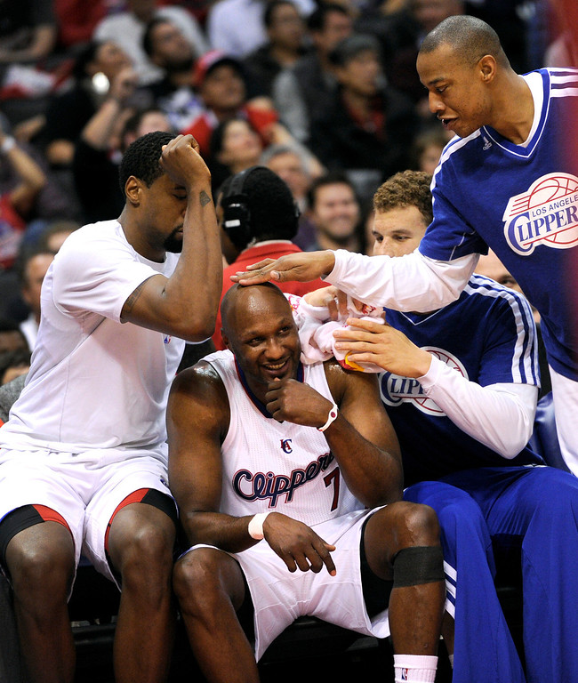. The Clippers DeAndre Jordan, left, Blake Griffin and Caron Butler, right, have fun with Lamar Odom\'s sweaty head after he came out of the game in the fourth quarter against the Warriors Saturday, January 5, 2012, at Staples Center. (Michael Owen Baker/Los Angeles Daily News)