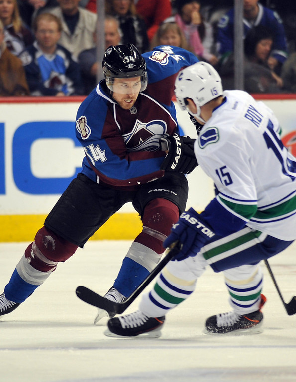 . DENVER, CO. - APRIL 13 : David Jones of Colorado Avalanche (54) and Derek Roy of Vancouver Canucks (15) are in action during the 1st period of the game at Pepsi Center. Denver, Colorado. April 13, 2013. (Photo By Hyoung Chang/The Denver Post)