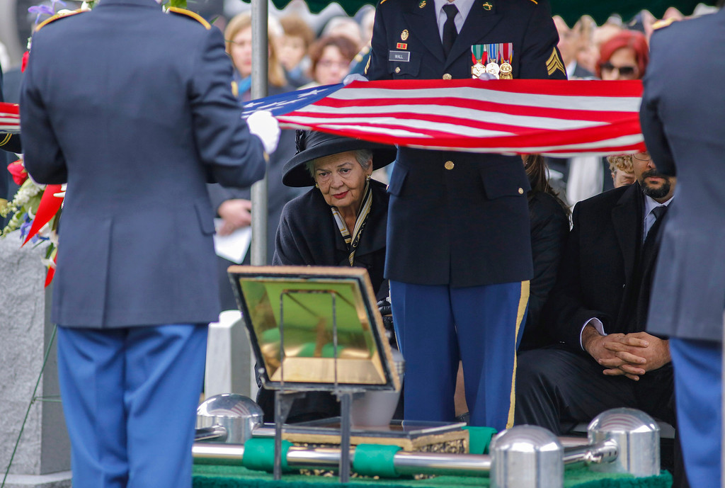 . Brenda Schwarzkopf, center, watches as an honor guard folds a flag over an urn containing the ashes of her late husband, Gen. Norman Schwarzkopf,  at the United States Military Academy on Thursday, Feb. 28, 2013, in West Point, N.Y.  (AP Photo/Philip Kamrass)