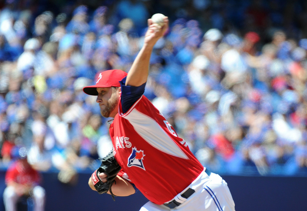 . Toronto Blue Jays\' Mark Buehrle pitches against the Detroit Tigers during the first inning of a baseball game on Sunday, Aug. 10, 2014, in Toronto.  (AP Photo/The Canadian Press, Jon Blacker)