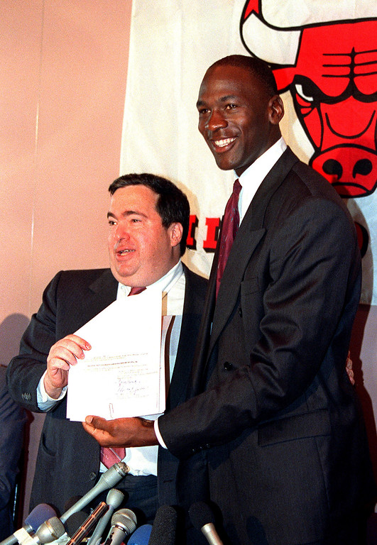 . FILE - In this Sept. 21, 1988, file photo, Chicago Bulls\' Michael Jordan, right, is all smiles after he signed a new contract with the NBA basketball team as general manager Jerry Krause looks on during a news conference in Chicago, Ill. Krause, the executive behind the Bulls\' six NBA titles, has died, the team announced Tuesday, March 21, 2017. He was 77.   (AP Photo/Mark Elias, File)