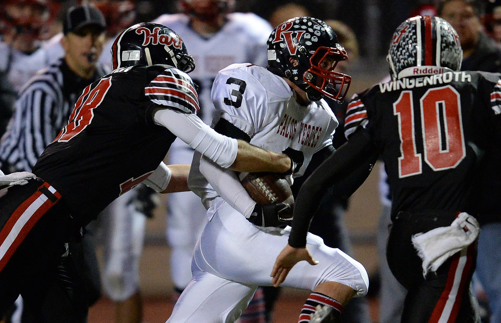 . Hart�s David Rowden #18 strips the ball away from Palos Verdes� Tyler Moore # causing a fumble that Hart recovered during their CIF Northern Division playoff game at College of the Canyons in Santa Clarita Friday November 22, 2013. (Photos by Hans Gutknecht/Los Angeles Daily News)