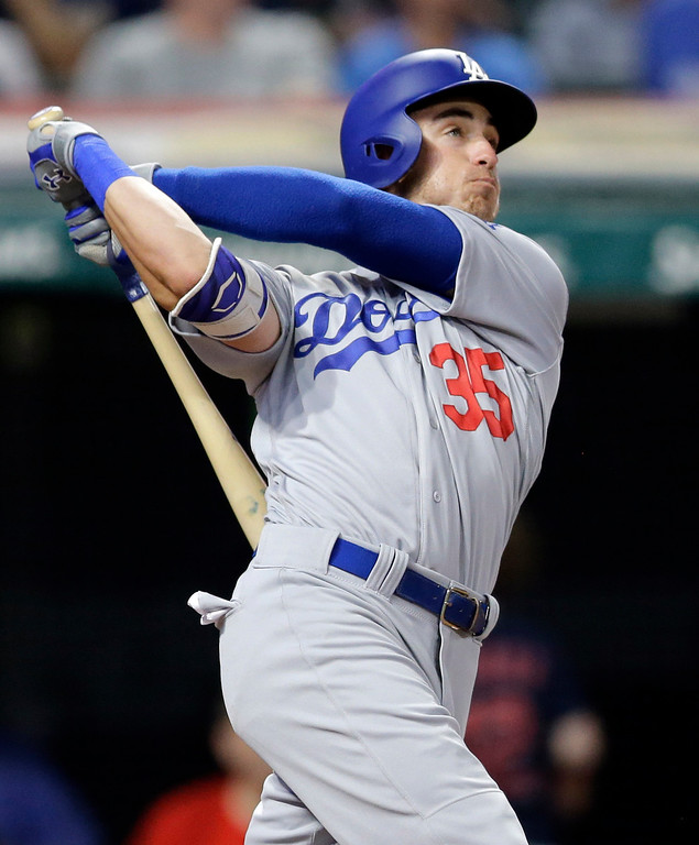 . Los Angeles Dodgers\' Cody Bellinger follows through on a solo home run off Cleveland Indians relief pitcher Andrew Miller during the eighth inning of a baseball game, Tuesday, June 13, 2017, in Cleveland. (AP Photo/Tony Dejak)