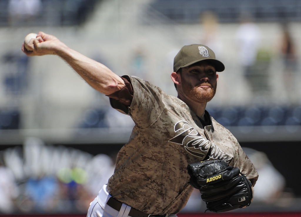 . Ian Kennedy #22 of the San Diego Padres pitches during the first inning of a baseball game against the Colorado Rockies at Petco Park on September 8, 2013 in San Diego, California.  (Photo by Denis Poroy/Getty Images)