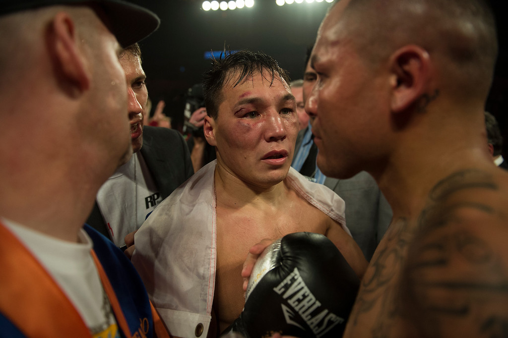 . BROOMFIELD, CO. - October 19: Ruslan Provodnikov talks with Mike Alvarado after their fight was stopped after 10 rounds at the 1st Bank Center October 19, 2013 Broomfield, Colorado. (Photo By Joe Amon/The Denver Post)