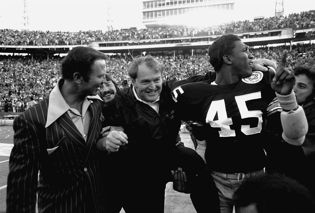 . ** FILE ** In this Jan. 18, 1976, file photo, Pittsburgh Steelers coach Chuck Noll, center, leaves the field with Jim Allen (45) who holds up his finger indicating the Steelers are No. 1 after defeating the Dallas Cowboys 21-17 in Super Bowl X at the Orange Bowl in Miami. Now that Pittsburgh is headed to its seventh Super Bowl, each of the Steelers\' three coaches in the last 40 years has taken them there. Noll first got there in his sixth season in 1974, Bill Cowher in his fourth. Mike Tomlin needed only two years after unexpectedly being hired for one of the best-known coaching jobs in American pro sports. (AP Photo/Phil Sandlin, File)