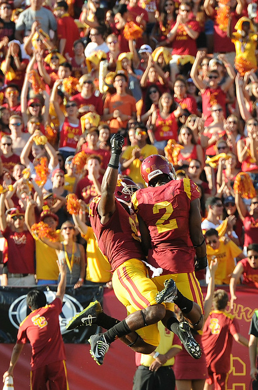 . USC #9 JuJu Smith jumps up to celebrate with #2 Adoree\' Jackson after Jackson made a TD catch in the 2nd quarter. USC played Fresno State at the Los Angeles Memorial Coliseum for the first game of the year. Los Angeles, CA. 8/30/2014(Photo by John McCoy Daily News