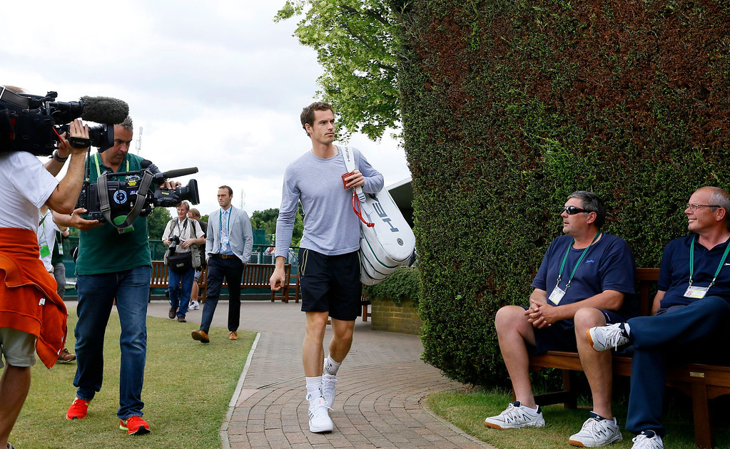 . Andy Murray of Britain arrives for a practice session ahead of his Men\'s singles semifinal match on Friday at the All England Lawn Tennis Championships in Wimbledon, London, Thursday, July 4, 2013. (AP Photo/Kirsty Wigglesworth)
